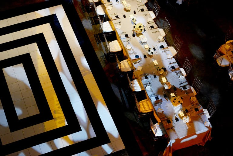 Wedding Reception Table With Black and White Dance Floor With Concentric Rectangles | PartySlate