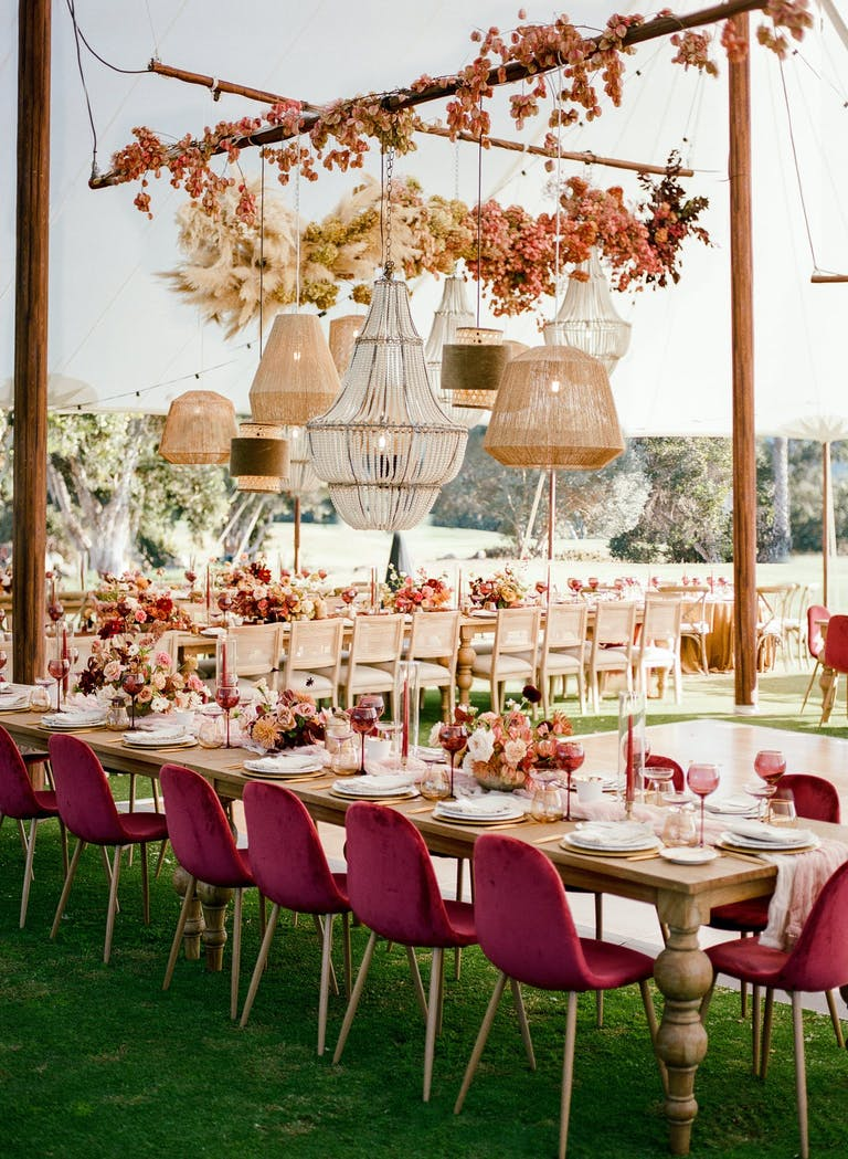 Rustic floral wedding with draping chandeliers and berry decal | PartySlate