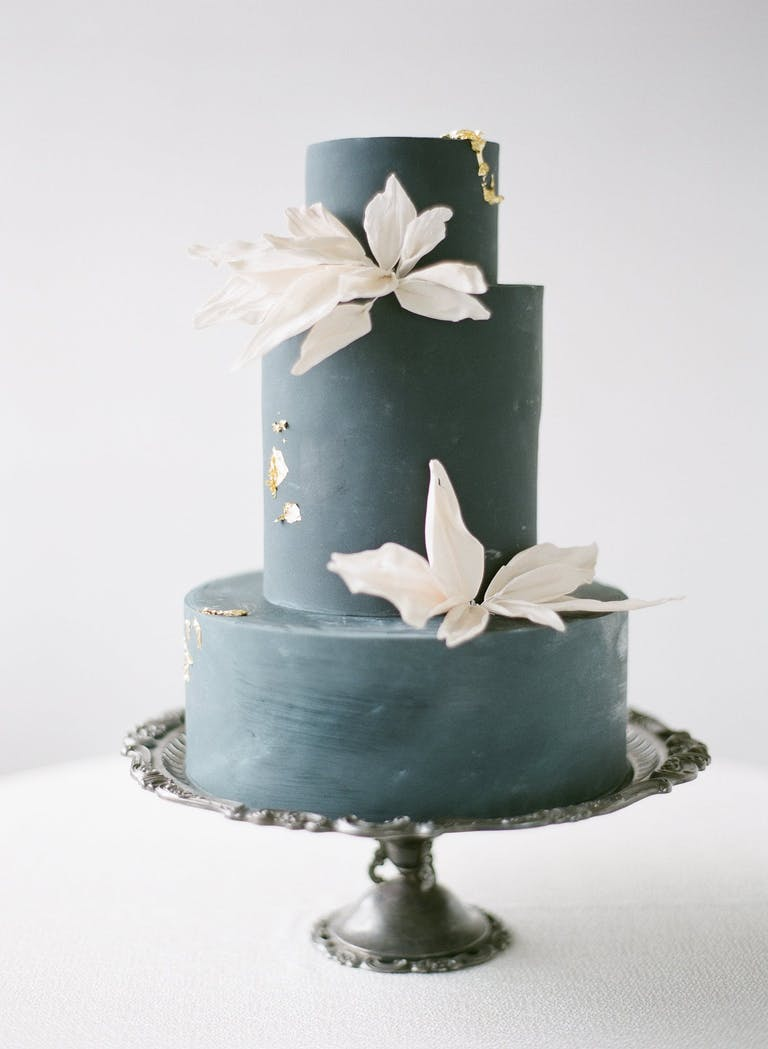 Black Monochrome Wedding Cake With Gold Details and White Blooms | PartySlate
