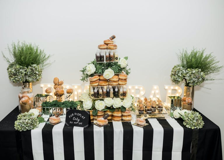 Wedding Donut Display With Black and White Striped Linen | PartySlate