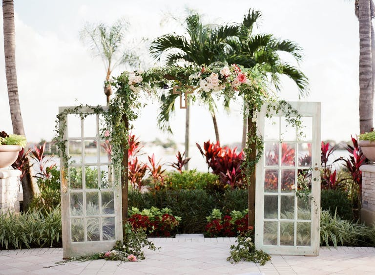 Outdoor wedding at PGA National Resort with Unique Ceremonial Door Backdrop | PartySlate