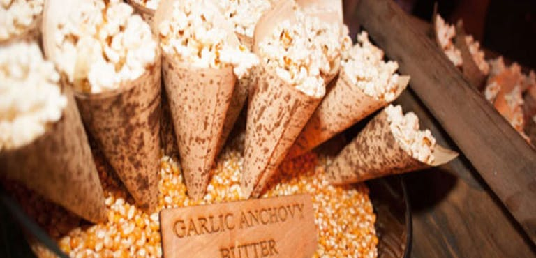 Savory Pop Corn in Paper Cone by Work of Art Catering | PartySlate