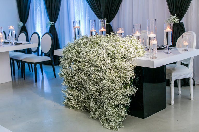 Black and White Wedding with Baby's Breath Cascading Off Sweetheart Table | PartySlate
