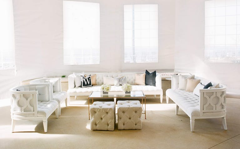 Black and White Wedding Lounge Area with Champagne Accent Pillows | PartySlate