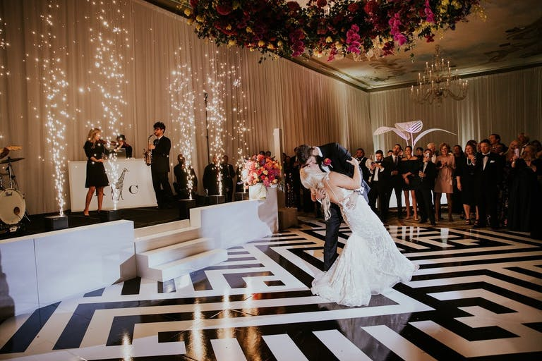 Black and White Art Deco Dance Floor With Cold Fireworks and Colorful Wreath Ceiling Installation | PartySlate