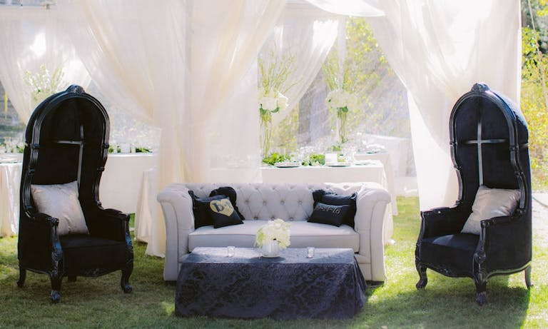 Outdoor Wedding With Gothic Black and White Lounge Area and Ethereal White Tenting | PartySlate