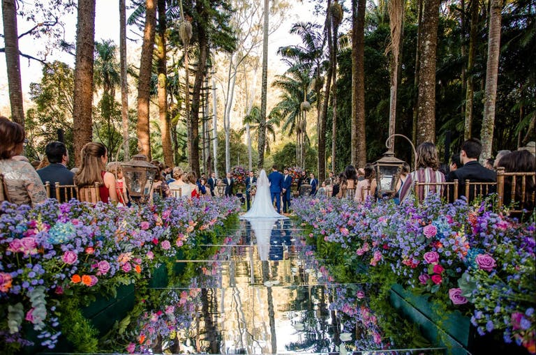 Stunning outdoor wedding with a beautiful aisle | PartySlate