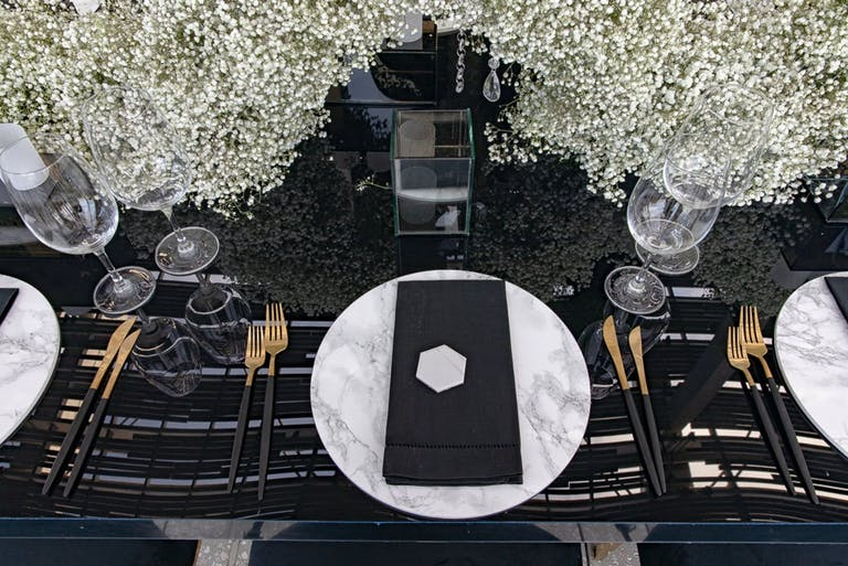 Black and White Wedding Tablescape With Baby's Breath Décor | PartySlate