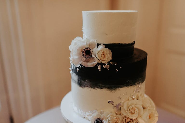 Black and White Wedding Cake With Blush-Toned Blooms | PartySlate