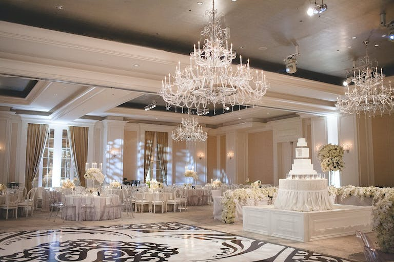 Ballroom Wedding With Glittering Chandeliers and Black and White Decal Dance Floor | PartySlate