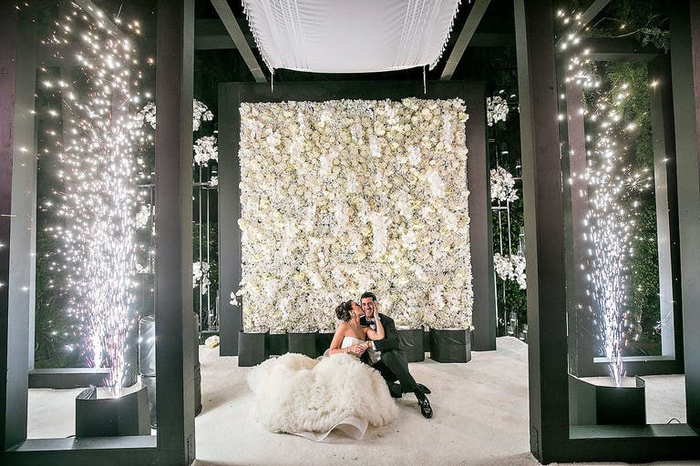 Black and White Wedding Ceremony with Roses and Cold Fire Works | PartySlate