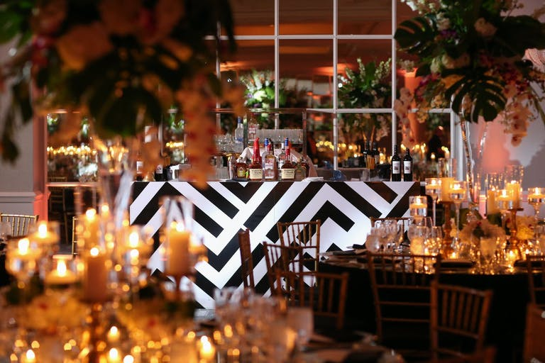 Wedding Reception With Black and White Art Deco-Style Bar Area and Tropical Décor | PartySlate