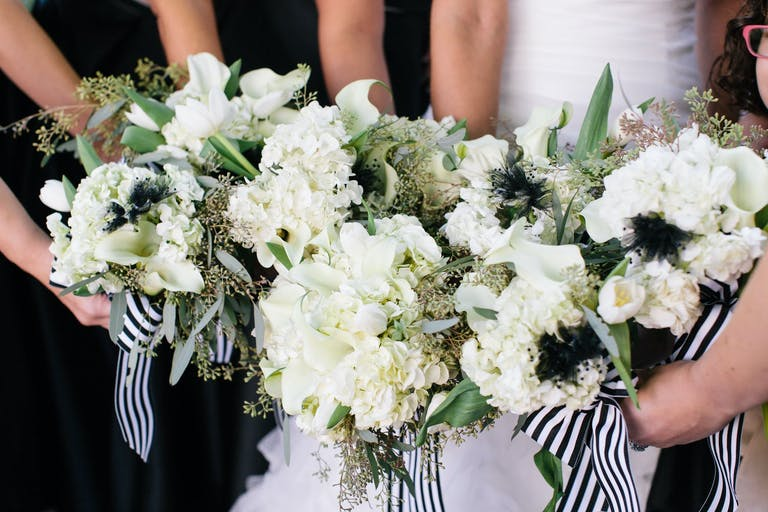 White Bridal Bouquets with Black and White Striped Ribbons | PartySlate