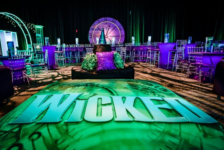 Wicked themed Bat Mitzvah with detailed decor | PartySlate
