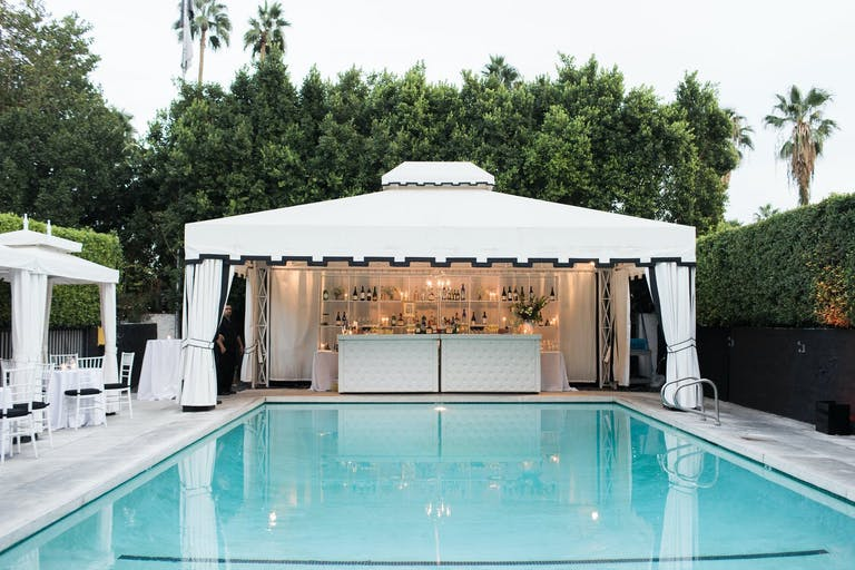 Pool Area with Black and White Cabana Bar Area | PartySlate