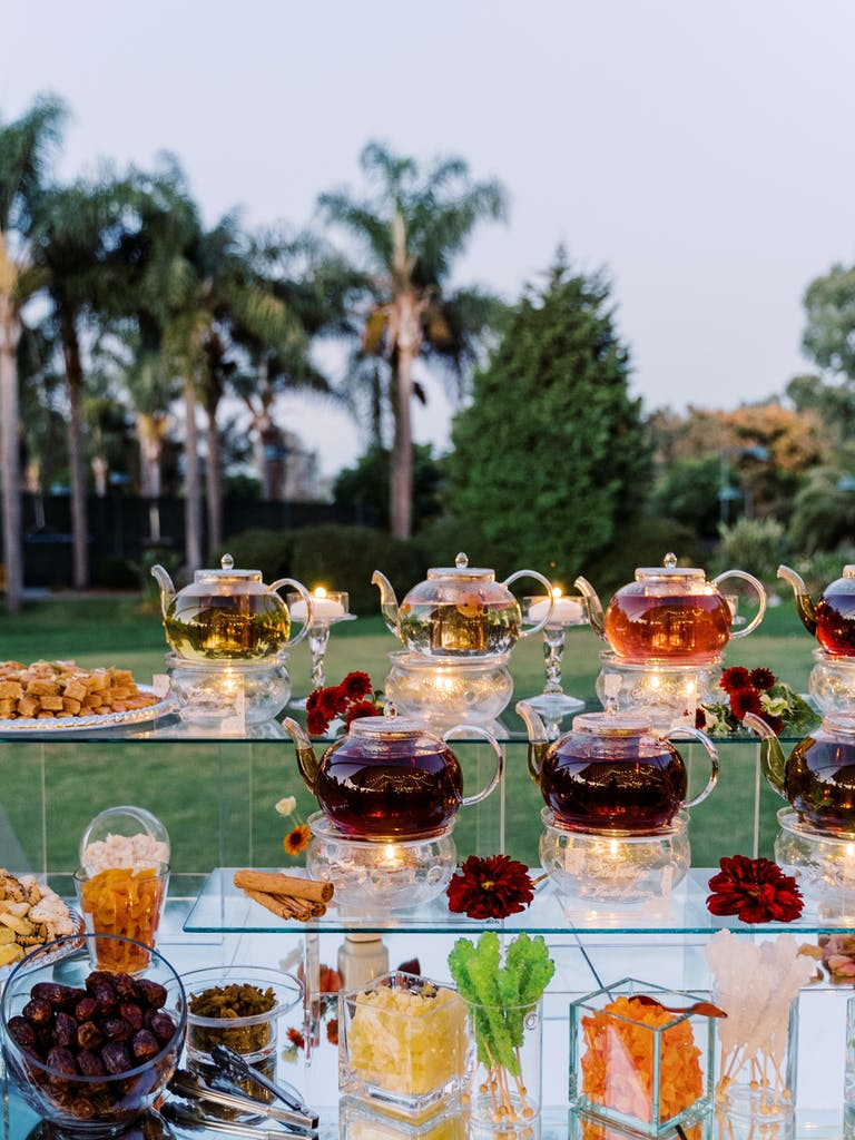 Rustic Floral Wedding at the Park Hyatt Aviara Carlsbad CA With Glass Tea Pots | PartySlate