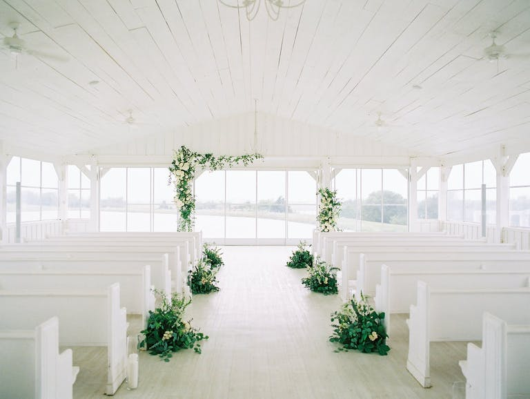 Modern Minimalist Wedding Ceremony in All-White Space With Simple Greenery Décor   PartySlate