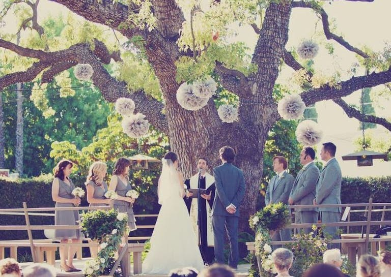 Wedding With Giant Tree Backdrop and Tissue Paper Pom Pom Décor | PartySlate