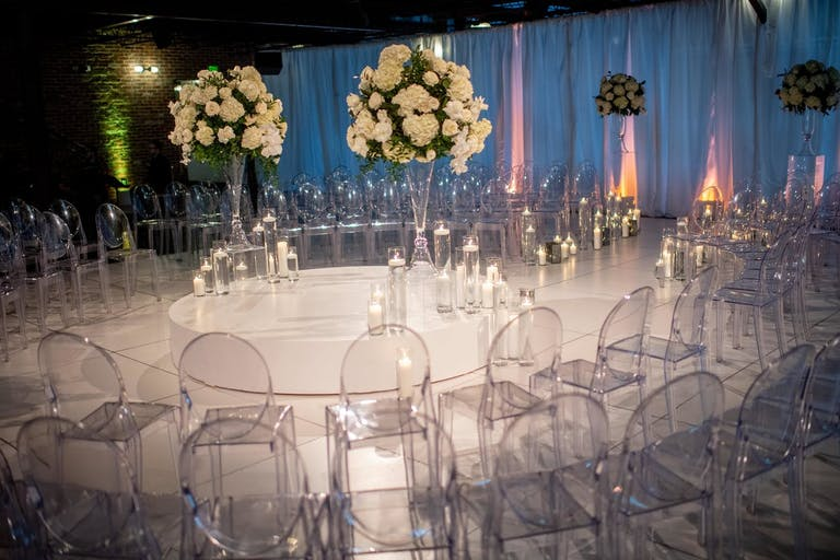 Acrylic see-through chairs at modern wedding reception   PartySlate