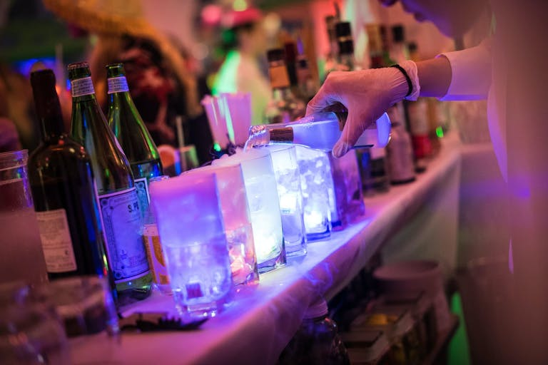 Glow-in-the-Dark Cocktails at Mad Hatter-Themed Party   PartySlate
