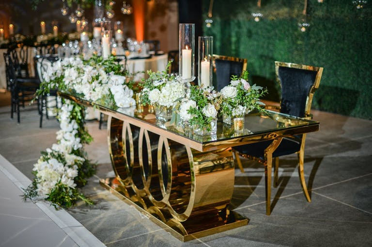 Black velvet and gold table for a modern wedding   PartySlate