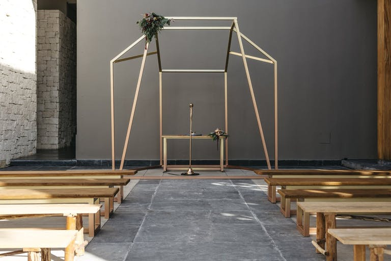 Geometric gold wedding arch   PartySlate