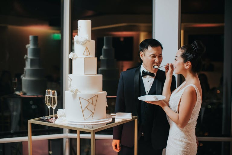 White wedding cake with shapes as the design   PartySlate