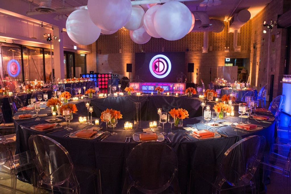 Torus-Shaped Table With Pink Balloon Ceiling Décor at Bat Mitzvah Party | PartySlate