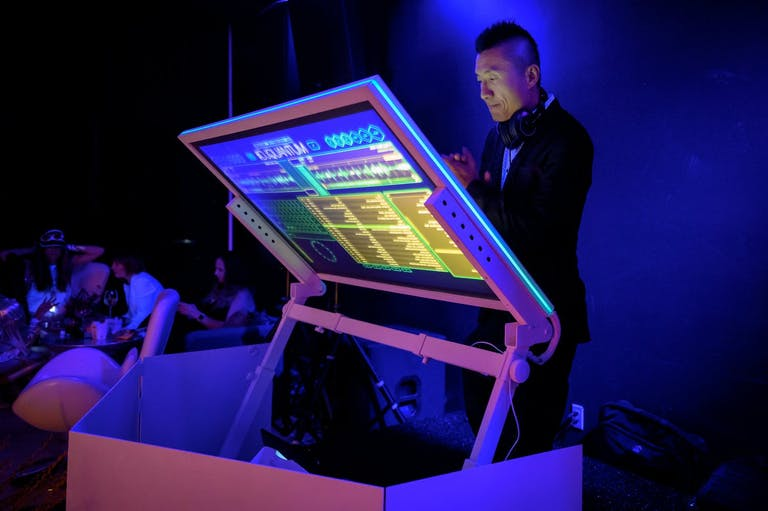 DJ with Neon Digital Screen at Neon Party   PartySlate