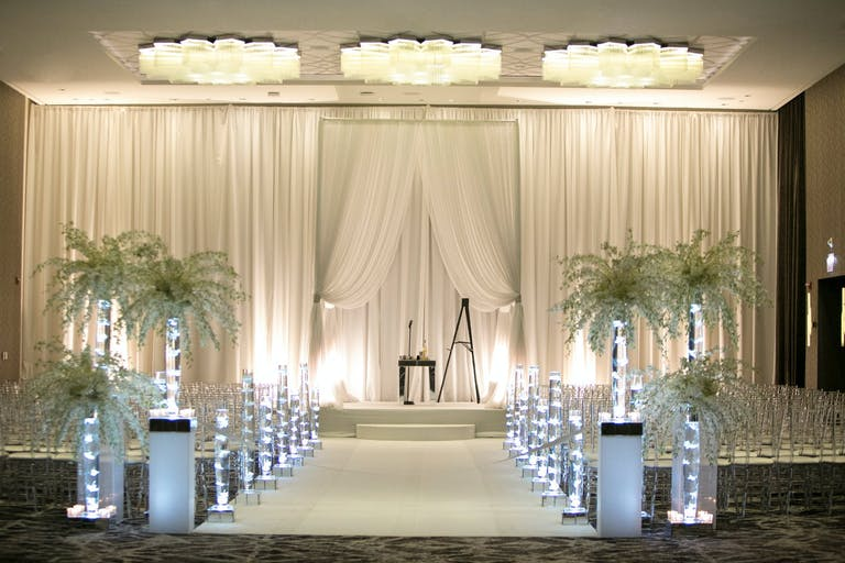 Modern Wedding Ceremony With White Drapery Backdrop and Candlelit Aisle Markers   PartySlate