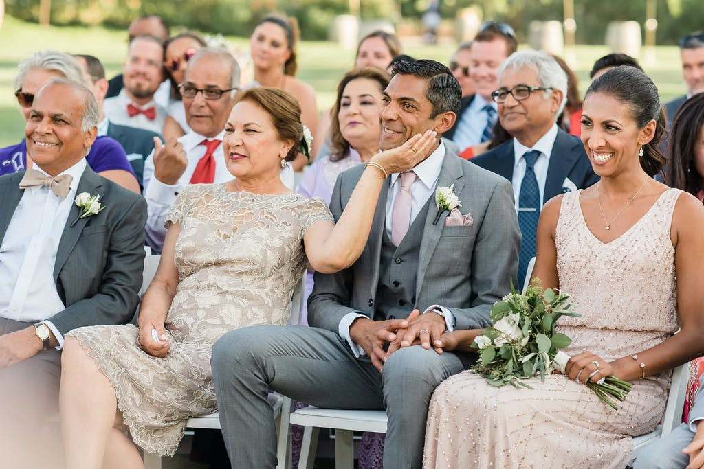 Wife Lovingly Pats Husband's Cheek as They Watch Child Get Married | PartySlate