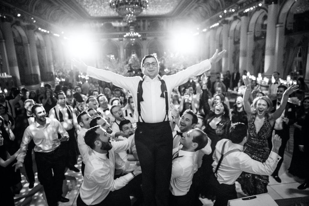Man Falls Back Into Arms of Guests on the Dance Floor | PartySlate