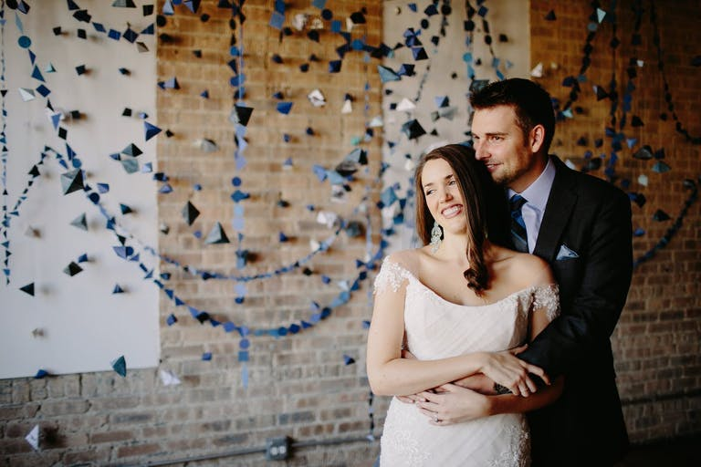 An origami backdrop for a modern wedding   PartySlate