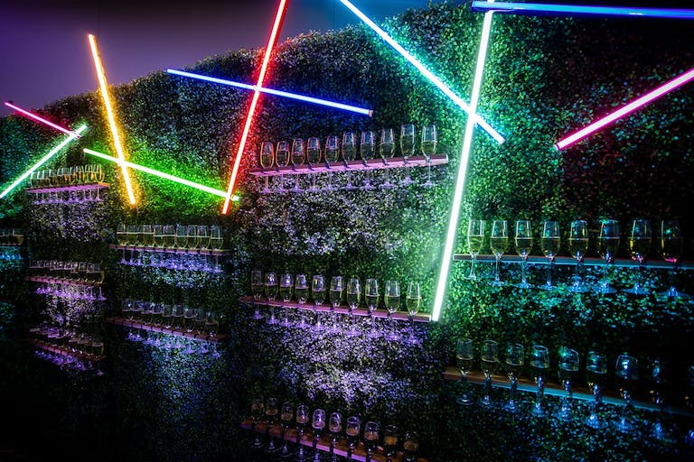 Champagne Wall with Colorful Laser Lights at Neon-Themed Gala   PartySlate