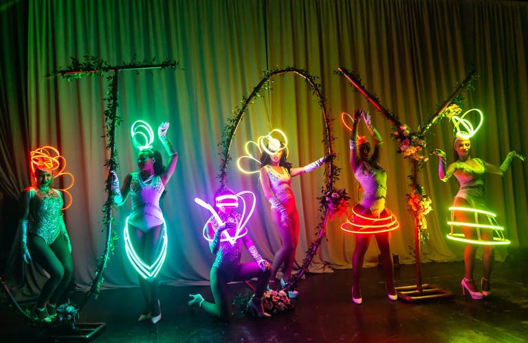 Performers in Neon Costumes at Neon Party   PartySlate