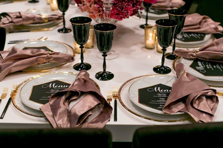 Modern wedding with silk blush pink napkins with black glassware   PartySlate