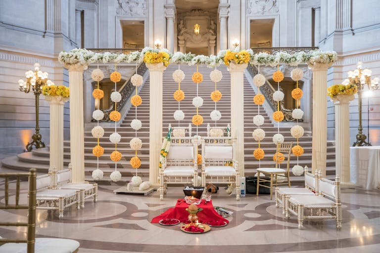 Unique Wedding Ceremony Backdrop with Yellow and White Rose Pom-Poms | PartySlate