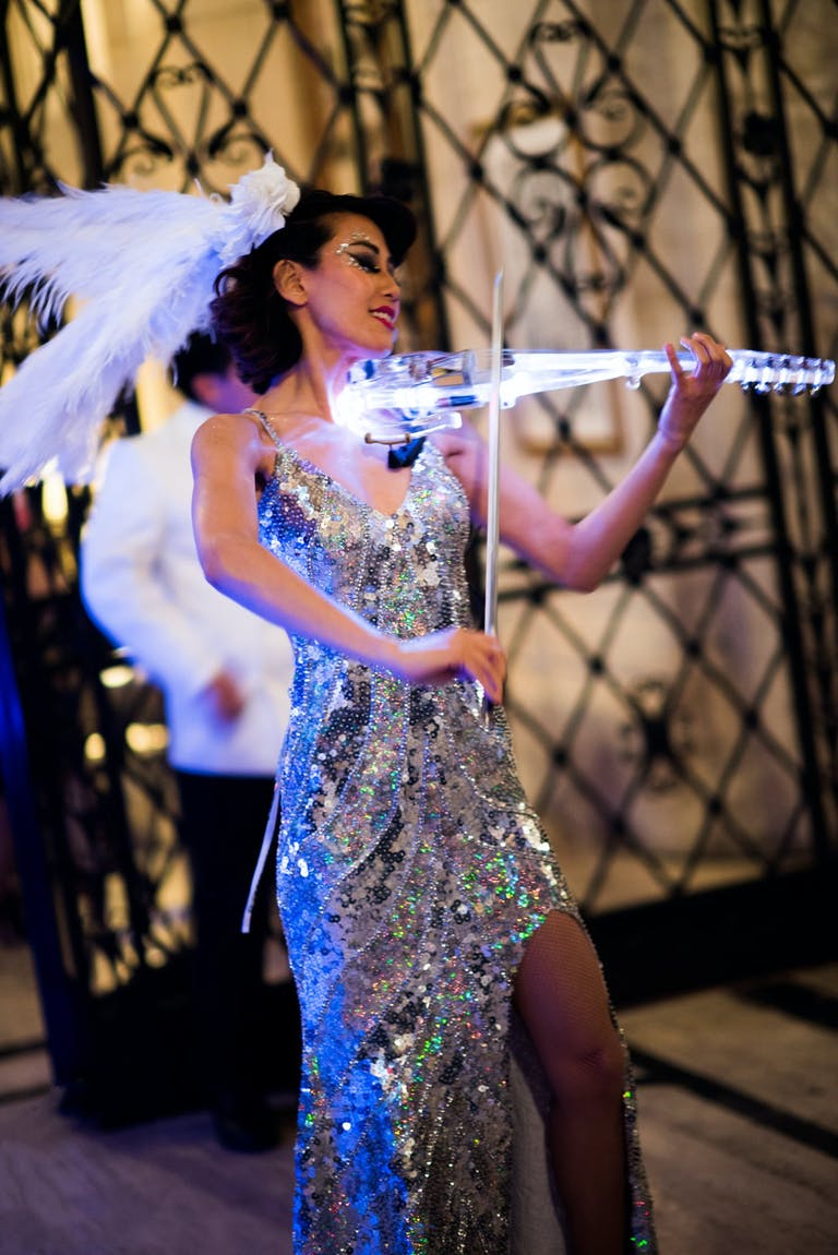 Woman Play Glow-in-the-Dark Violin at Neon-Themed Party   PartySlate