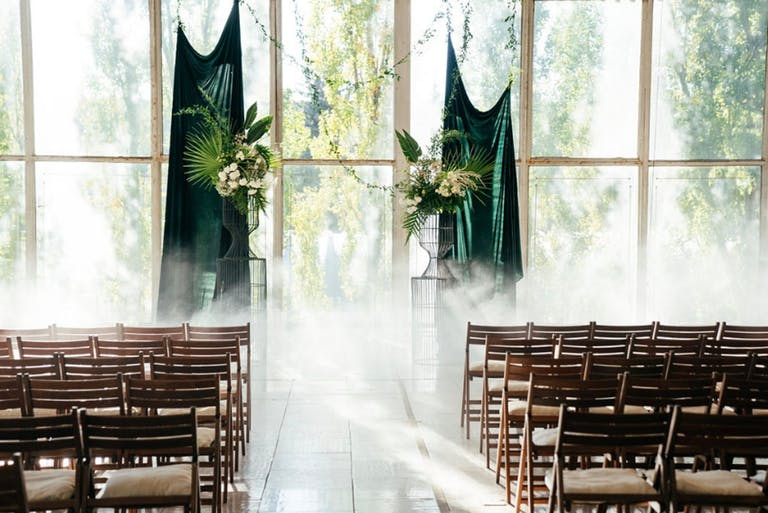 Modern Wedding Ceremony With Green Velvet Curtain Backdrop   PartySlate