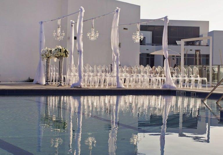 Towering floral arrangements at modern wedding   PartySlate
