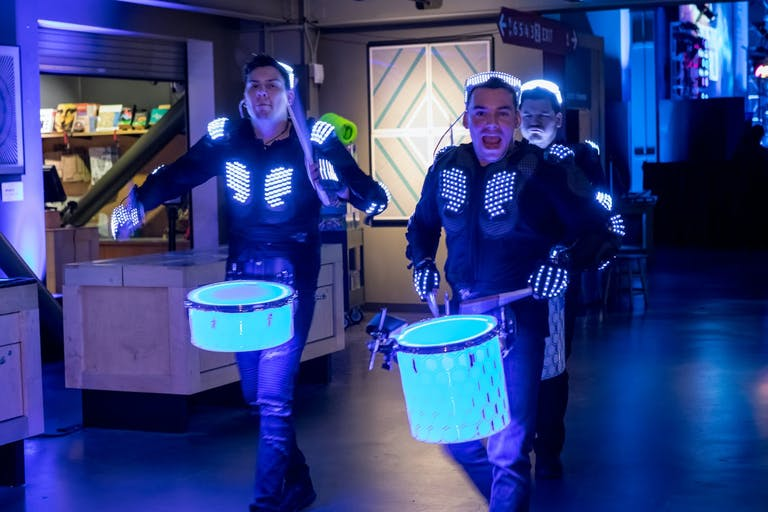 Marching Drummers with Glow-in-the-Dark Blue Drums   PartySlate