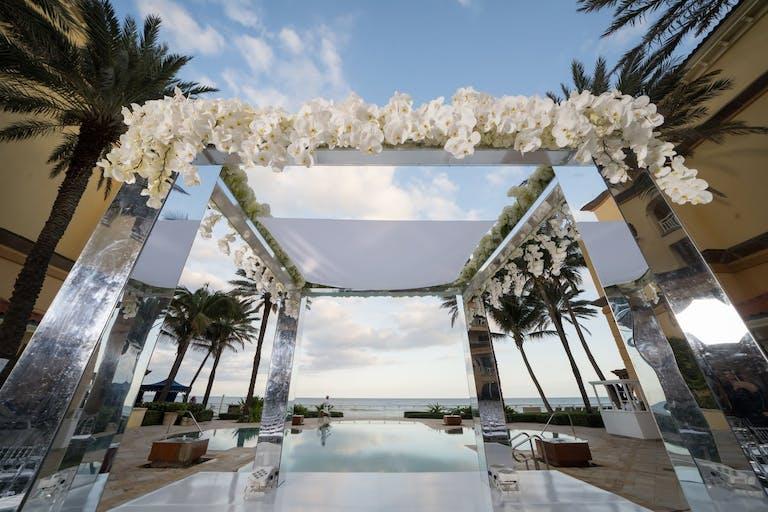 Mirrored wedding arbor for a modern wedding   PartySlate