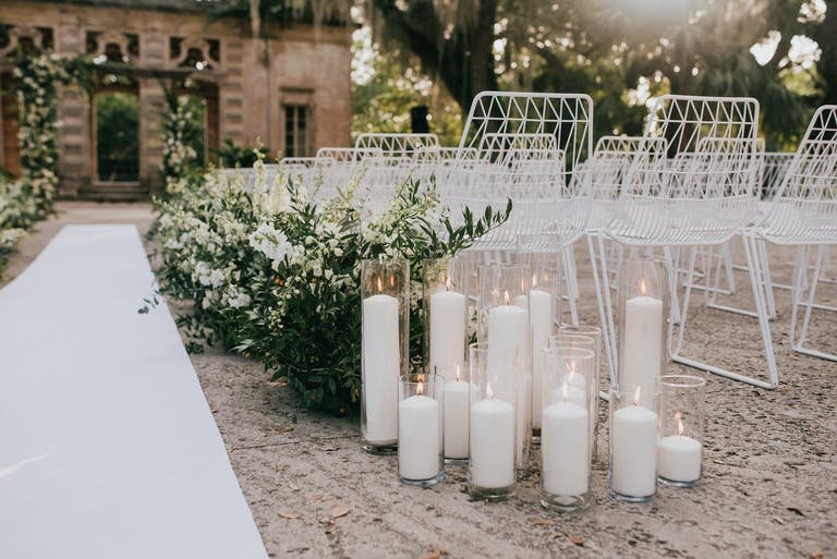 Clear glass candle holder with white large candles   PartySlate