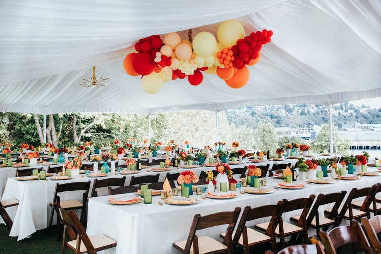 Warm colored balloon installation for a modern wedding   PartySlate