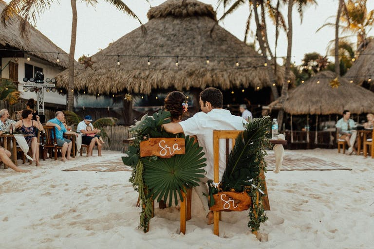 Beachfront wedding with tropical ambiance | PartySlate