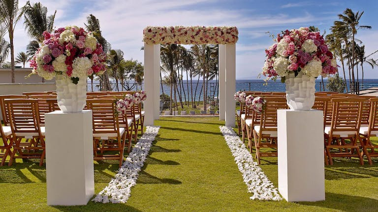 Hawaii wedding with pink and white florals and stone accents | PartySlate