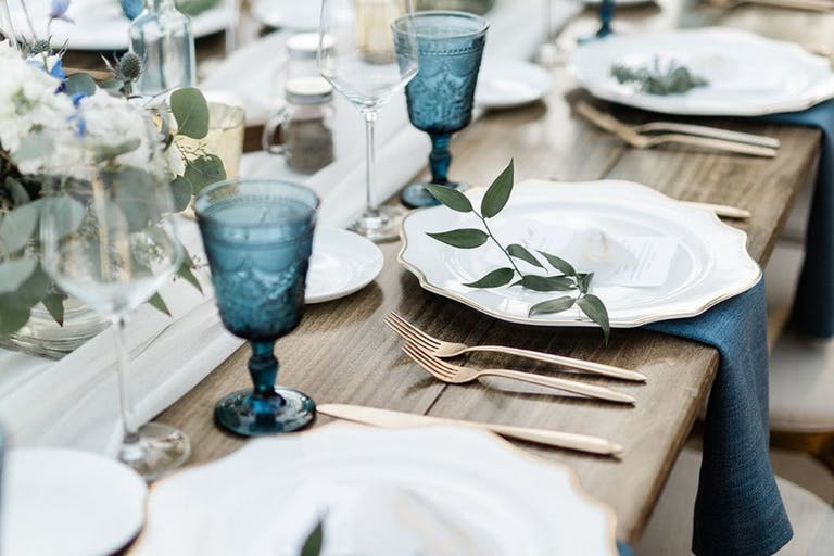 Rustic Wedding Tablescape With Blue Goblets