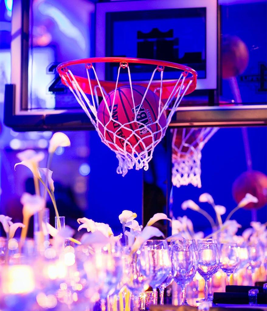 centerpiece at a blue Bar Mitzvah with basketball hoop and basketball décor