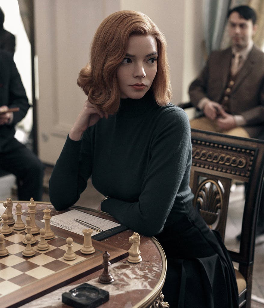 Beth Harmon in front of a chess board from The Queen's Gambit