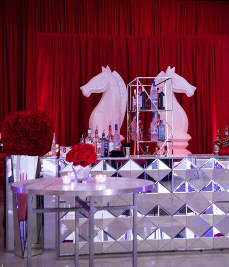 Life size Knight chess pieces as decoration behind a Bar Mitzvah bar